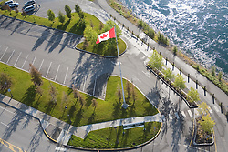 Aerial photo of Canada flag, parking lot and Yukon River in Whitehorse
