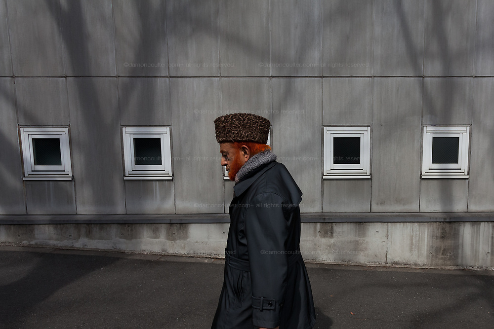 An older immigrant Muslim man with his hair and beard dyed orange with henna near Tokyo Camii mosque in Yoyogi Uehara, Tokyo, Japan. Friday March 22nd 2019.   The Tokyo Camii Mosque is the largest mosque in Japan where estimate currently put the immigrant and native population of Muslims at around 130,000.