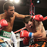 ORLANDO, FL - OCTOBER 04: Esquiva Falcao, 2012 Olympic silver medalist from Brazil (L), punches Austin Marcum during a professional boxing match at the Bahía Shriners Auditorium & Events Center on October 4, 2014 in Orlando, Florida. (Photo by Alex Menendez/Getty Images) *** Local Caption *** Esquiva Falcao; Austin Marcum