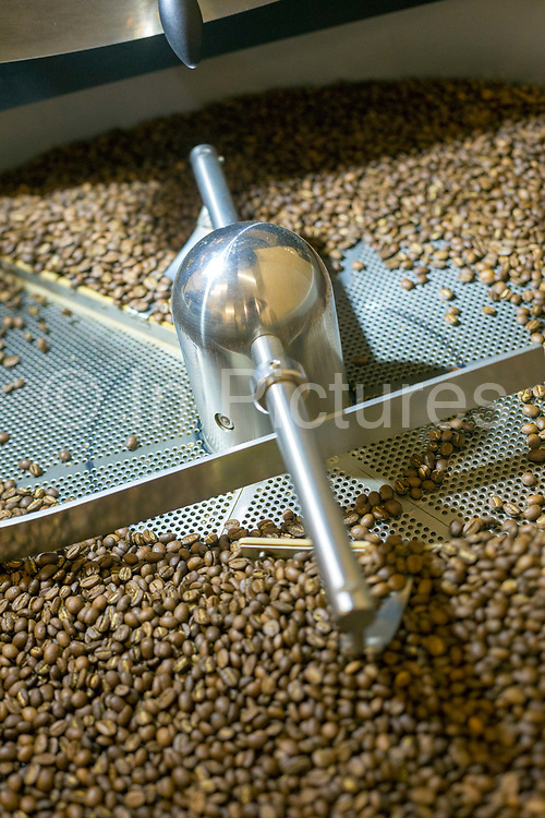 Coffee beans roasting at Blue Tokai Coffee shop in Champa Gali, New Delhi, India. Champa Gali is the latest and most intimate of Delhis urban creative villages.