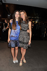 Left to right, SAVANNAH MURPHY and HEATHER KERZNER at the launch of Samsung's NX Smart Camera at charity auction with David Bailey in aid of Marie Curie Cancer Care at the Bulgari Hotel, 171 Knightsbridge, London on 14th May 2013.