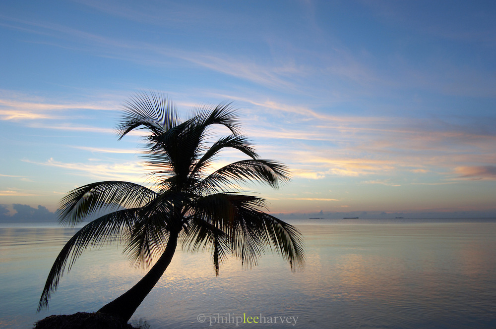 Sunrise on tropical beach, Carribean Sea, Placencia, Belize