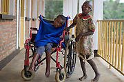 May0016089 . Daily Telegraph..Features..Christine, 16 yrs and Sifa 12 yrs, two of the orphans residing at the Ngwino Nawe (Come To Us) Children's Village built by Rwanda Aid a British charity and recipient of funds from the Daily Telegraph's 2005 Christmas appeal..Built in Ntendezi in south west Rwanda, the village acts as both home and school for orphans, some victims of the 1994 genocide, and the mentally and physically handicapped...Rwanda 28 August 2009