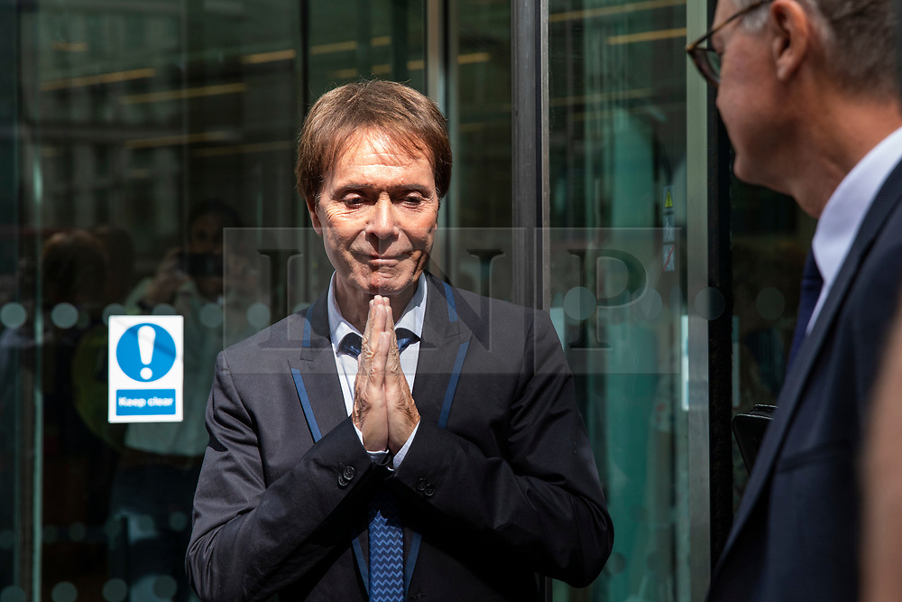 © Licensed to London News Pictures. 18/07/2018. London, UK. SIR CLIFF RICHARD holds his hands together in prayer as he leaves the Rolls Building of the High Court in London winning his claim for damages against the BBC for loss of earnings. The 77-year-old singer sued the corporation after his home in Sunningdale, Berkshire was raided following allegations of sexual assault made to Metropolitan Police. Photo credit: Rob Pinney/LNP