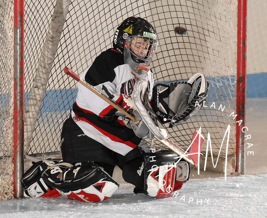Laconia Pee Wee goalie C.J. Tsantoulis tries to block a shot during Saturday's game against the NHE Eagles at the Laconia Ice Arena.  (Alan MacRae/for the Citizen)