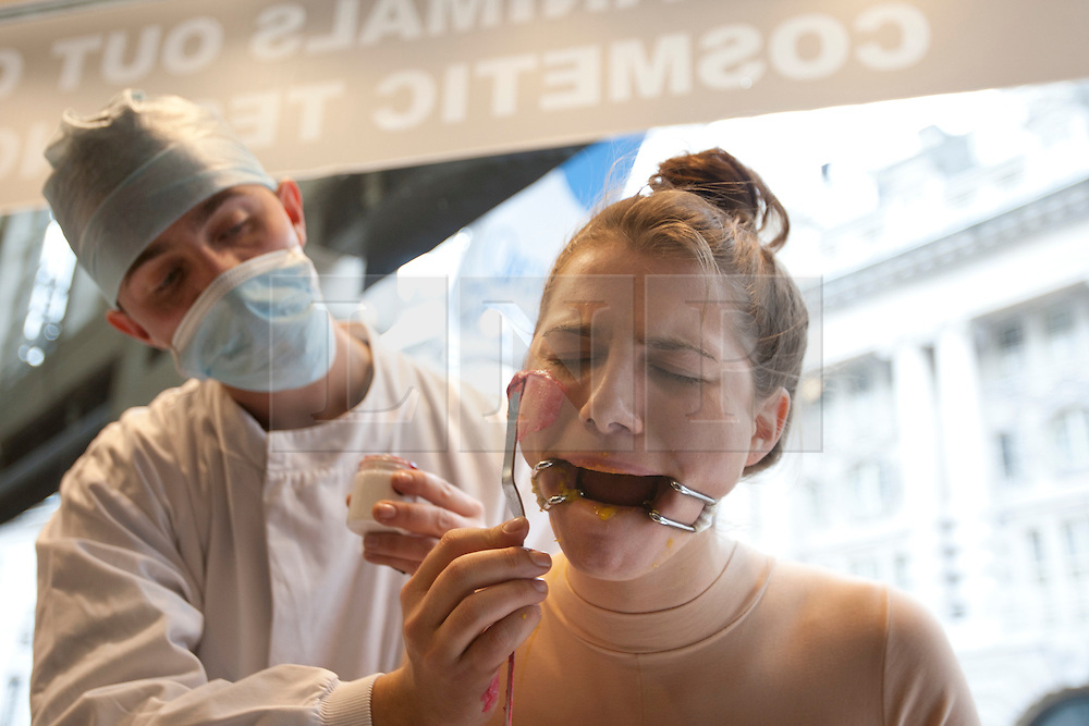 © licensed to London News Pictures. London, UK 24/04/2012. A girl being subjected to four common animal tests including, being force-fed, having her eye irritated and bandaged, her skin braised and being injected with ingredients as Lush Cosmetics and Humane Society International launched their campaign to end cosmetics testing on animals, today in a Lush store on Regent Street (24/04/12). Photo credit: Tolga Akmen/LNP