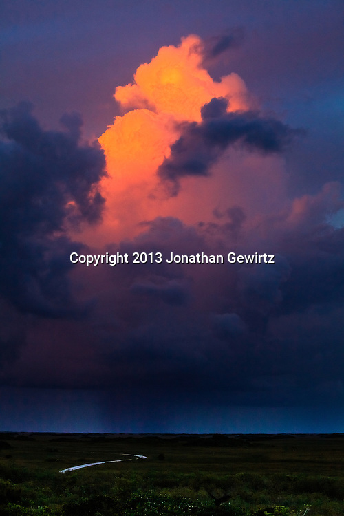 The last rays of the setting sun illuminate an isolated thunderstorm near the Shark Valley section of Everglades National Park, Florida. WATERMARKS WILL NOT APPEAR ON PRINTS OR LICENSED IMAGES.