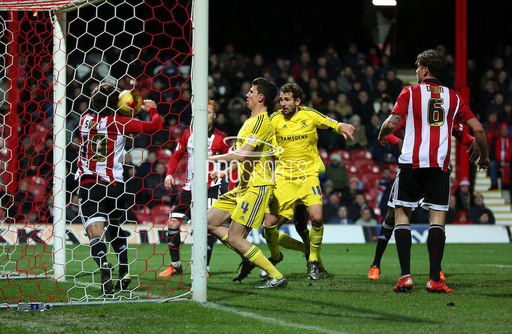 Middlesbrough defender Daniel Ayala and the first goal during the Sky Bet Championship match between Brentford and Middlesbrough at Griffin Park, London, England on 12 January 2016. Photo by Matthew Redman.