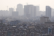 Cityscape of Hanoi showing a high density of buildings organized in layers with low level houses in foreground and skyscrapers in background. Vietnam, Asia