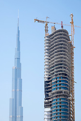 construction of new apartment tower and Burj Khalifa in Business Bay district in Dubai United Arab Emirates