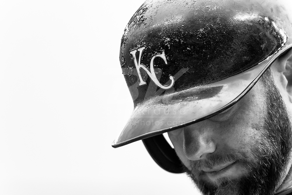 Alex Gordon #4 of the Kansas City Royals warms up on-deck during a game against the Minnesota Twins on April 13, 2014 at Target Field in Minneapolis, Minnesota.  The Twins defeated the Royals 4 to 3.  Photo by Ben Krause