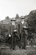 two male persons posing for an image countryside 1930s