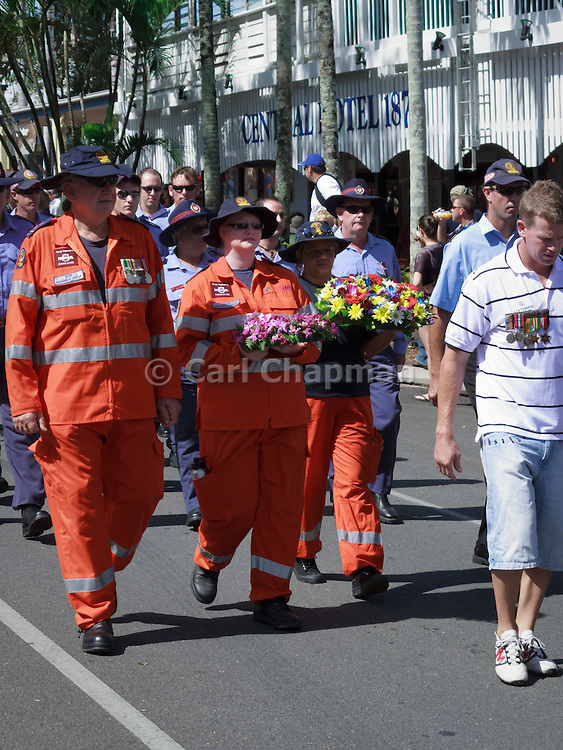 SES and Fire personnel marching during Port Douglas ANZAC Day parade 2009. <br /> <br /> Editions:- Open Edition Print / Stock Image
