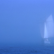 A sailboat comes into Lunenburg NS from the out in the fog. Fine Art title: Canadian Dutchman.  Photo by Roger S. Duncan.  ...