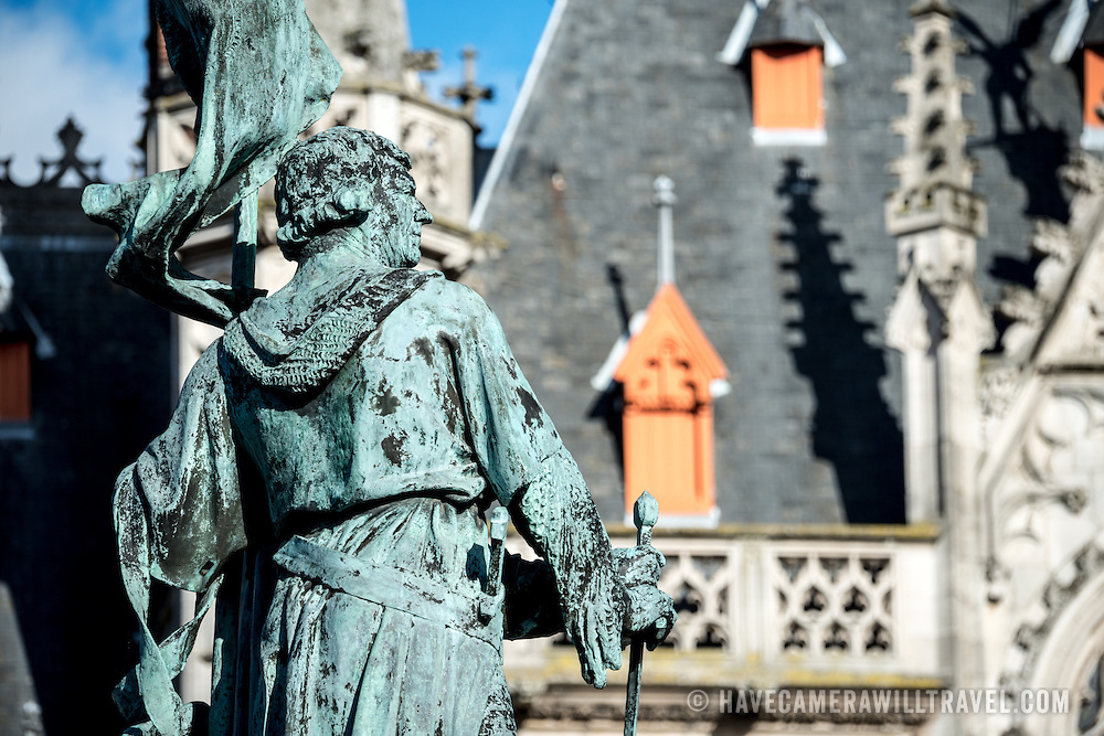 In the foreground is a statue of Jan Breydel and Pieter de Coninck in the Markt (Market Square) in the historic center of Bruges, a UNESCO World Heritage site. The two men, a weaver and a butcher, helped lead a Flemish rebellion against the occupying French in the Battle of the Golden Spurs on July 11, 1302. In the background is part of the Provincial Court building