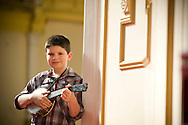 Joseph Hilditch, 10, from Stockport, one of the fans attending the George Formby Appreciation Society's annual gathering in Blackpool, practicing on his ukulele prior to playing to the audience at the town's Winter Gardens. The society was formed in 1961 and holds an annual event to celebrate the life of the famous Lancastrian singer and entertainer.