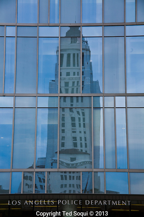 Reflected image of LA city hall on the LAPD headquarters building.