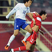 Turkey's Servet CETIN (R) and South Korean's Park Chu-YOUNG (L) during their International friendly soccer match Turkey between South Korean at the Avni Aker stadium in Trabzon, Turkey on Wednesday 09 February 2011. Photo by TURKPIX