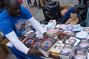 Anti-lockdown and conspiracy theory literature on sale as Coronavirus deniers protest in Trafalgar Square for personal freedoms and against the government and mainstream media who, they say, are behind disinformation and  untruths about the covid pandemic, on 29th August 2020, in London, England.