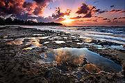 Clouds reflecting in the tide pools on the lava reef at sunset in Turtle Bay on Oahu's north shore in Hawaii