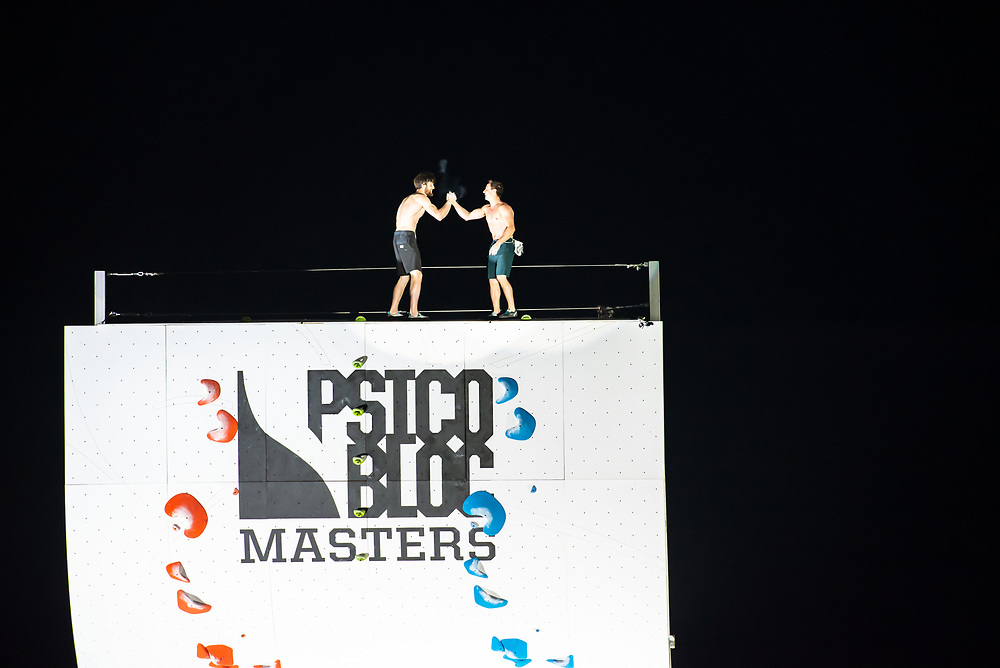 Jimmy Webb and Carlo Traversi celebrate a close semifinal races in the 2018 Psicobloc Masters competition.