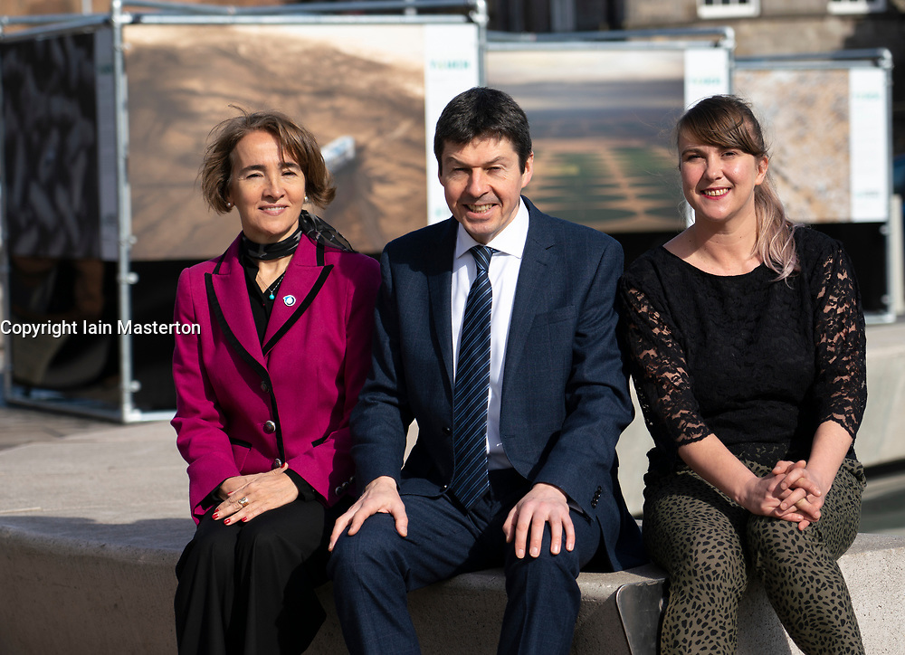 Edinburgh, Scotland, UK. 20 March, 2019. The  opening of a major outdoor photography exhibition highlighting the impact humans have on the natural world, called  A Human Touch, in front of the Scottish Parliament as part of Edinburgh Science Festival. Pictured L to R, Oceana's Communications Director Marta Madina , the Scottish Parliament's Presiding Officer, Ken Macintosh MSP and Edinburgh Science Festival's Festival and Creative Director Amanda Tyndall,