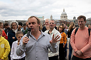 Ewan Jones from the Green Party Somerset speaks at the Rise For Climate Change event held outside Tate Modern in London, England, United Kingdom on September 8th 2018. Tens of thousands of people joined over 830 actions in 91 countries under the banner of Rise for Climate to demonstrate the urgency of the climate crisis. Communities around the world shined a spotlight on the increasing impacts they are experiencing and demanded local action to keep fossil fuels in the ground. There were hundreds of creative events and actions that challenged fossil fuels and called for a swift and just transition to 100% renewable energy for all. Event organizers emphasized community-led solutions, starting in places most impacted by pollution and climate change. Photographed for 350.org.