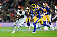 Cincinnati Bengals Wide receiver Auden Tate (19) is tackled by LA Rams Defensive back Troy Hill (22) during the International Series match between Los Angeles Rams and Cincinnati Bengals at Wembley Stadium, London, England on 27 October 2019.