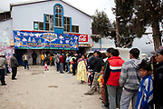 People queuing up outside the venue In El Alto, fights take place every Sunday. Lucha Libre wrestling origniated in Mexico, but is popular in other latin Amercian countries, including in La Paz / El Alto, Bolivia. Male and female fighters participate in the theatrical staged fights to an adoring crowd of locals and foreigners alike.
