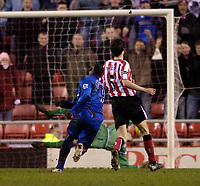 Photo: Jed Wee.<br /> Sunderland v Middlesbrough. Barclays Premiership. 31/01/2006.<br /> <br /> Middlesbrough's Jimmy Floyd Hasselbaink (L) strikes the ball past the dive of Sunderland goalkeeper Kelvin Davies to score their third goal.