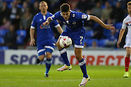 Ryan Flynn of Oldham Athletic tries to make some space in the box for a shot during the EFL Cup match between Oldham Athletic and Wigan Athletic at Boundary Park, Oldham, England on 9 August 2016. Photo by Simon Brady.