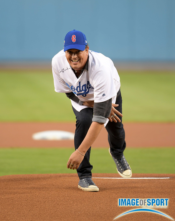 Sep 6, 2016; Los Angeles, CA, USA; Recording artist Carlos Vives throws out the ceremonial first pitch during a MLB game between the Arizona Diamondbacks and the Los Angeles Dodgers at Dodger Stadium.