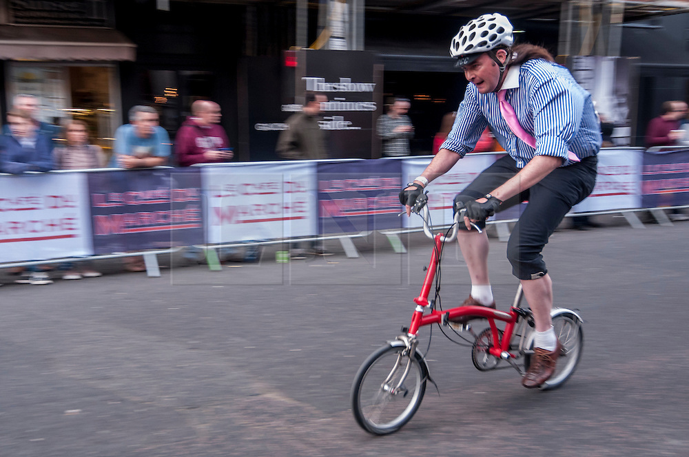 © Licensed to London News Pictures. 06/06/2015. London, UK.   Riders in the popular folding bike race, as the 9th edition of the award winning Jupiter London Nocturne hits the streets of Farringdon.  The event brings the best criterium racing to the fast and technical race circuit around Smithfield Market, with a mix of elite and amateur races for male and female riders. Photo credit : Stephen Chung/LNP