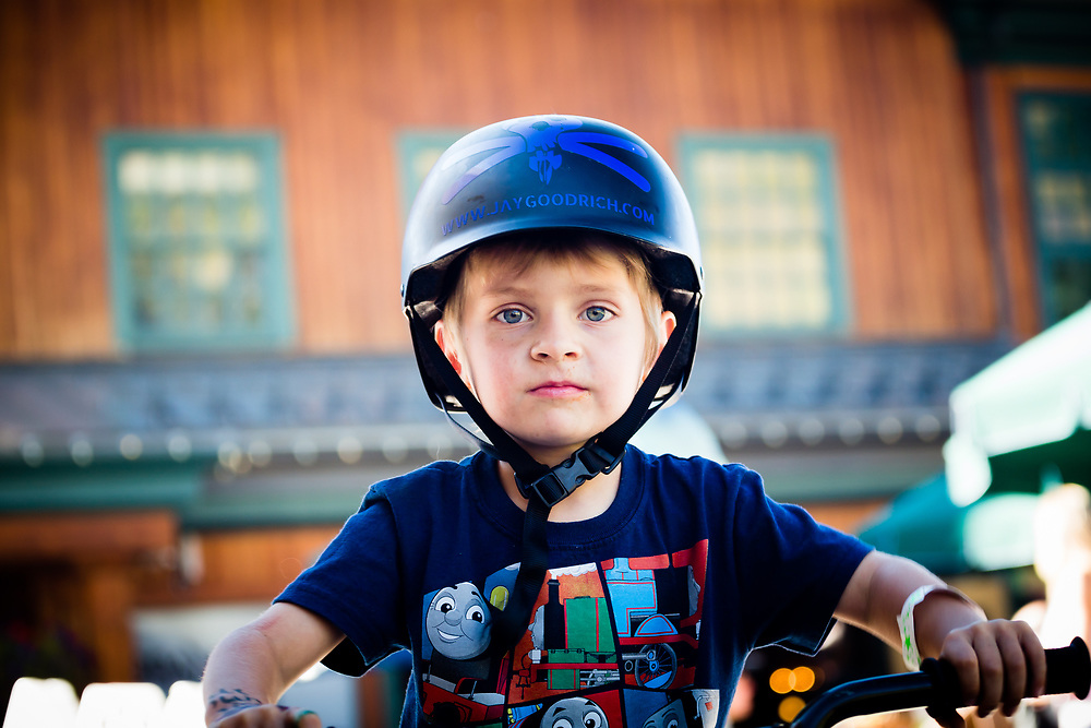 Micah Goodrich takes a moment to stare at the camera for a portrait while riding his bike around the village at Grand Targhee Resort in Alta, Wyoming.