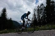 """Passo S. Pellegrino. Corridore da corse a tappe, professionista dal 2005, ha vinto la Vuelta a España 2010 e il Giro d'Italia 2013, due edizioni della Tirreno-Adriatico, ed è il secondo italiano, dopo Felice Gimondi, ad essere salito sul podio di tutti e tre i Grandi Giri[1]. Ha vinto il titolo di campione nazionale italiano nel giugno 2014. È soprannominato """"Lo squalo dello Stretto"""" fin da dilettante, per via del suo modo di correre sempre all'attacco[2.   s an Italian professional road bicycle racer, considered one of the strongest stage race riders of these years. He rides for the Kazakhstani UCI ProTeam Astana.[2] Born near the Strait of Messina, his nickname is the """"Shark of the Strait"""" or simply """"The Shark"""".[3][4] His first major win came at the 2006 GP Ouest-France, where he beat an impressive field on a tough course. However, experts such as Michele Bartoli have said Nibali is most suited to competing in multi-stage races.[5] Nibali's biggest wins to date are the 2010 Vuelta a España and the 2013 Giro d'Italia. He has also won two editions of the Tirreno-Adriatico stage race."""