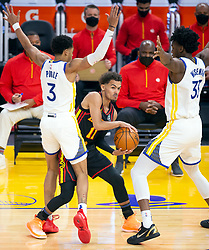 Mar 26, 2021; San Francisco, California, USA; Atlanta Hawks guard Trae Young (11) looks for a passing outlet between Golden State Warriors guard Jordan Poole (3) and center James Wiseman (33) during the first quarter of an NBA basketball game at Chase Center. Mandatory Credit: D. Ross Cameron-USA TODAY Sports