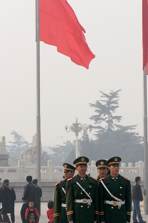 Soldiers at Tiananmen Square in Beijing, China begin to form a group for the rotation of the guards.