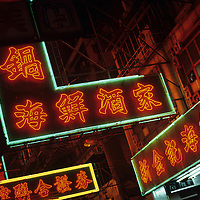 China, Hong Kong, Neon restaurant signs above crowded streets in Kowloon