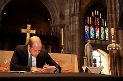 June 2, 2017 - Manchester, United Kingdom - Image licensed to i-Images Picture Agency. 02/06/2017. Manchester, United Kingdom. The Duke of Cambridge  signs a book of condolence at Manchester Cathedral where he met first responders and members of the local community who provided vital care and support to those affected by last week's suicide bomb attack, including representatives from St John's Ambulance, Northern Rail and the British Red Cross.  Picture by ROTA  / i-Images UK OUT FOR 28 DAYS (Credit Image: © Rota/i-Images via ZUMA Press)