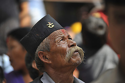 October 17, 2016 - Kathmandu, NP, Nepal - An old man observing festival as Locals carry as well as rotates top part of a chariot of Lord Narayan across the streets of Hadigaun during Lord Narayan jatra festival in Hadigaun, Kathmandu, Nepal on Monday, October 17, 2016. Once in a every year right after Dashain Festival this festival celebrates. The Narayan Jatra Festival of Hadigaun is a unique Festival in the capital involving three circular bamboo structures, above which an idol of the Lord Narayan in placed, and then rotated by two people standing below. (Credit Image: © Narayan Maharjan/NurPhoto via ZUMA Press)