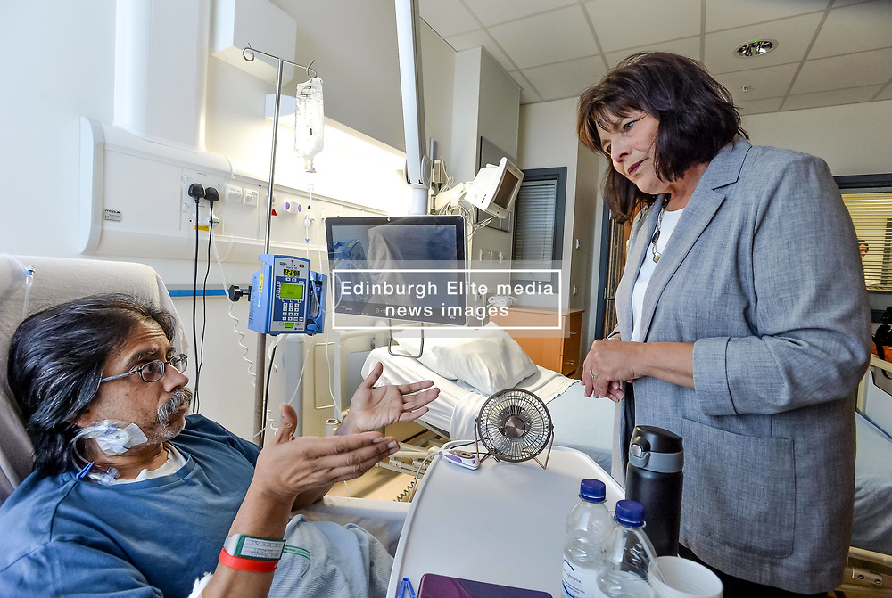 Pictured: Ms Freeman meets Khalid Mohamed from Edinburgh who has just had a transplant.<br /> <br /> Health Secretary Jeane Freeman visited patients waiting for transplants and successful transplant patients to highlight the uptake in organ donation registrations.<br /> <br /> © Dave Johnston / EEm