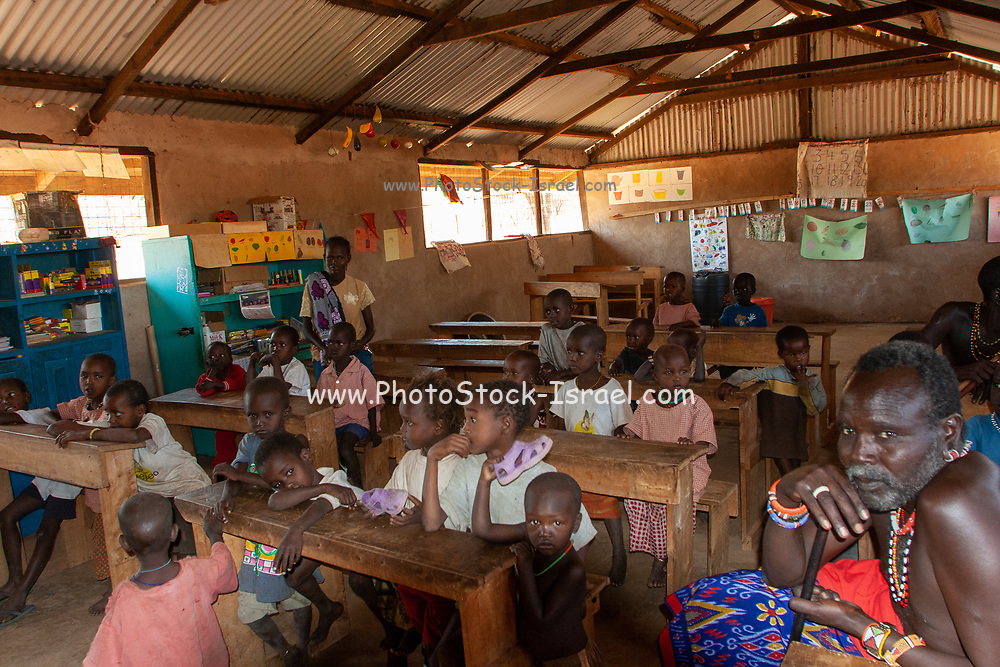 Children of the Samburu tribe in a classroom. The Samburu are a Nilotic people of north-central Kenya. Samburu are semi-nomadic pastoralists who herd mainly cattle but also keep sheep, goats and camels.
