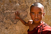 Portrait of a young monk in Kalaw, Myanmar with piercing eyes and blood red robes.