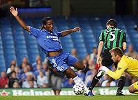 Photo: Chris Ratcliffe.<br /> Chelsea v Glasgow Celtic. Pre Season Friendly. 09/08/2006.<br /> Didier Drogba of Chelsea clashes with keeper Artur Boruc of Celtic.