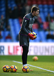 """Crystal Palace goalkeeper Wayne Hennessey warms up prior to kick off during the Premier League match at Selhurst Park, London. PRESS ASSOCIATION Photo. Picture date: Saturday January 13, 2018. See PA story SOCCER Palace. Photo credit should read: Daniel Hambury/PA Wire. RESTRICTIONS: EDITORIAL USE ONLY No use with unauthorised audio, video, data, fixture lists, club/league logos or """"live"""" services. Online in-match use limited to 75 images, no video emulation. No use in betting, games or single club/league/player publications"""