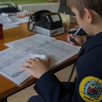 Boy works at the Huvosvolgy station of the Children's Railway in the Buda Hills in Budapest, Hungary on November 13, 2014. ATTILA VOLGYI