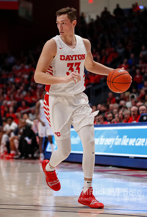 DAYTON, OH - FEBRUARY 08: Ryan Mikesell #33 of the Dayton Flyers brings the ball up court during the game against the Saint Louis Billikens at UD Arena on February 8, 2020 in Dayton, Ohio. (Photo by Michael Hickey/Getty Images) *** Local Caption *** Ryan Mikesell
