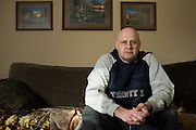 Clint Murphy poses for a photo at his home in Sulphur Springs, Texas on December 18, 2015. Murphy is one of many Americans who is opting to pay the penalty for not purchasing health insurance and pay out of pocket if needed. (Cooper Neill for The New York Times)