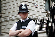 Policeman outside Downing Street in central London. Part of a strong security cordon protecting the home of the Prime Minister.