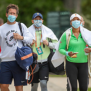 PARIS, FRANCE May 25. Naomi Osaka of Japan leaves practice on Court Simonne Mathieu with Yutaka Nakamura, trainer and Wim Fissette, coach during preparation for the 2021 French Open Tennis Tournament at Roland Garros on May 25th 2021 in Paris, France. (Photo by Tim Clayton/Corbis via Getty Images)